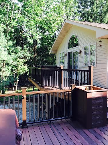 evergrain envisions shaded auburn pvc coated composite decking rettinger and fiberon mission deck railing